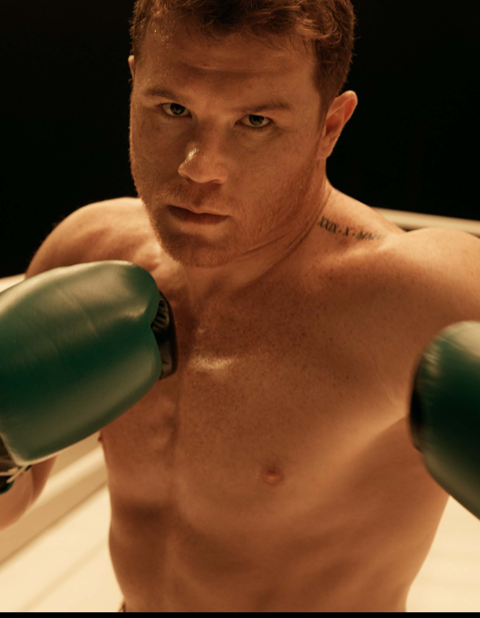World champion boxer Canelo Alvarez standing in the boxing ring, confident and intimidating.