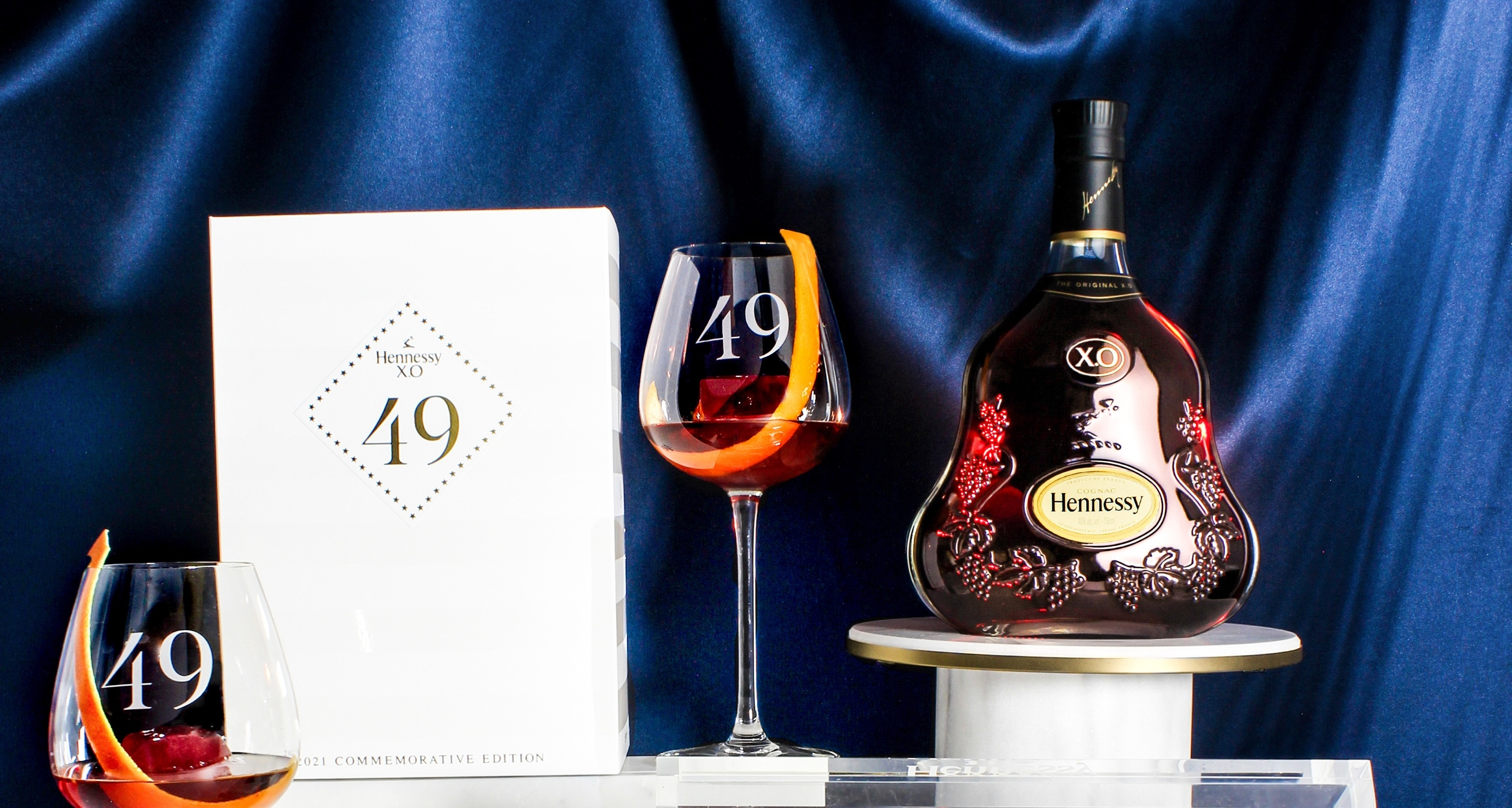 Hennessy X.O cognac 49 Commemorative set featuring etched glasses, ice trays, and limited edition packaging